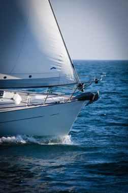 beach blue sky boat daylight